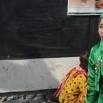 El vestido verde captó en un principio la atención del fotógrafo (detalle de la foto premiada).